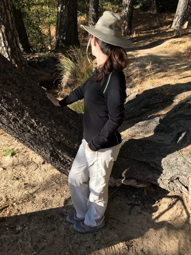 Hiking Lady wearing Woolpower Zip LITE