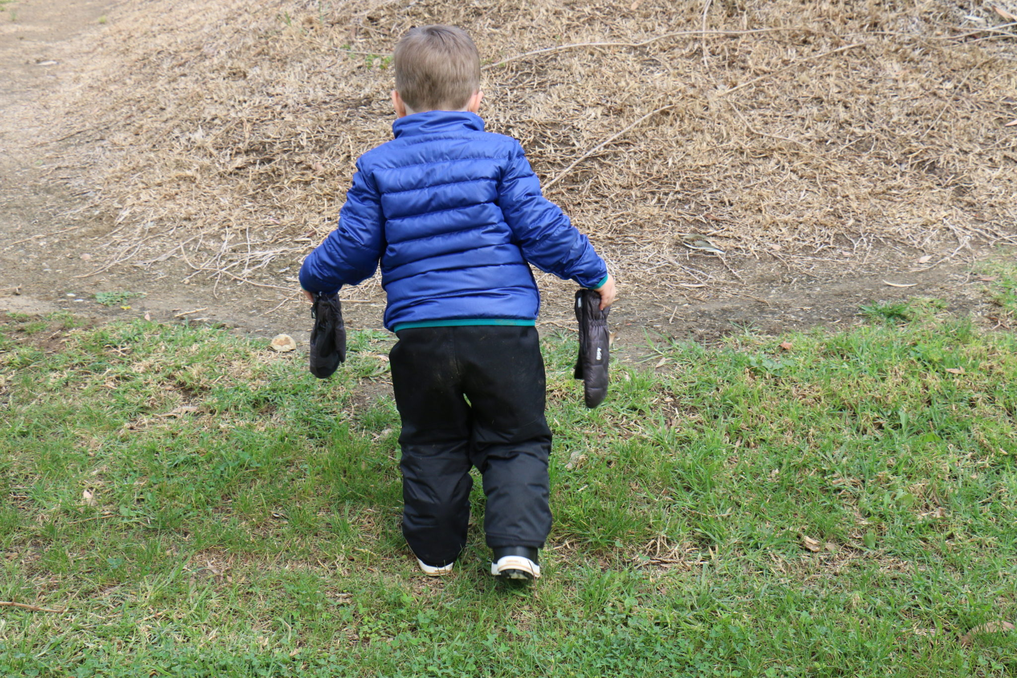 Hiking Toddler waiting for snow!